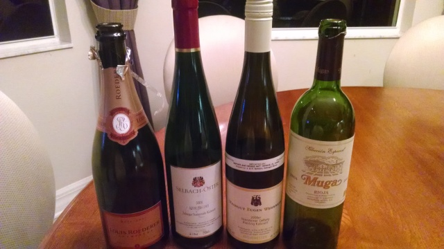 The evening's wines.  Not pictured:  a bottle of Calvados and a second bottle of Champagne.